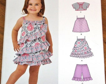 Simplicity New Look 6357 Dress, Sun Top, Jacket Shorts, Baby, Girls Sewing Pattern Size 1/2 1 2 3 4 Chest 19 20 21 22 23 Uncut Factory Folds