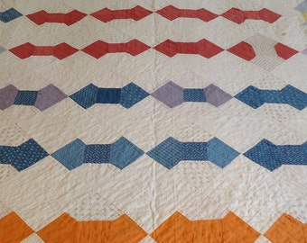 Handmade bow tie vintage quilt. Primary colors with red border