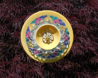 Glass Flower Garden Art  Ensemble with Plates, Glass, Ceramic, and other Treasures