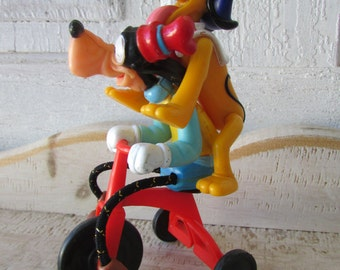 Walt Disney vintage collectible Goofy and Pluto on tricycle toy collectible