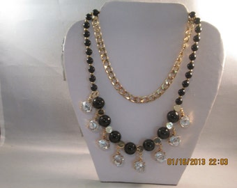 2 Strand Necklace with a Gold Tone Chain; Black and Gold  Beads and Clear Cystal Like Dangles
