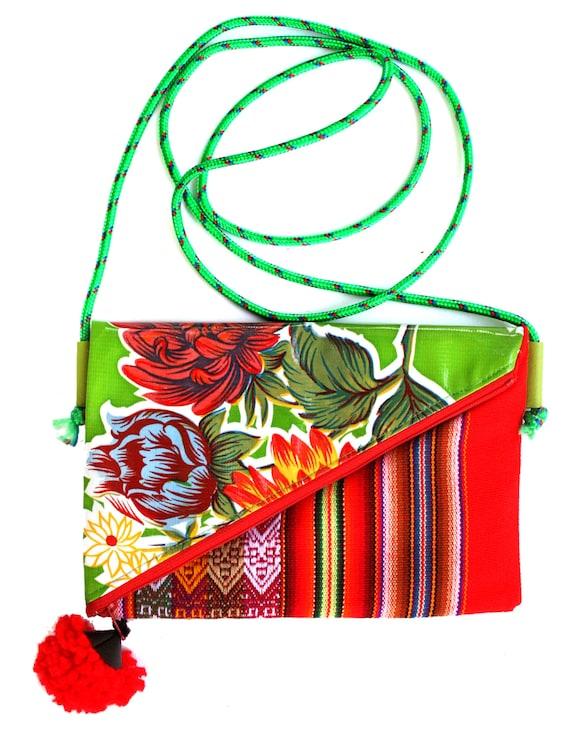 Small, pom pom, adjustable strap, lime green oil cloth, Peruvian stripes, cross body bag, flat bag