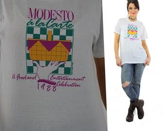 Retro shirt Vintage 1980s graphic tee white short sleeve oversize unisex hipster Modesto a la Carte print Large