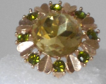 Vintage avon pin or pendant yellow and green stones with gold tone leaves