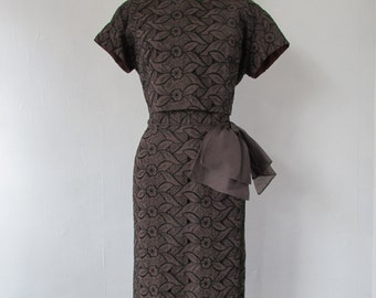 Vintage 1950s - 1960s dark chocolate embrodiered eyelet wiggle dress with bow | vintage 1950s brown wiggle dress | medium | The Marcia Dress