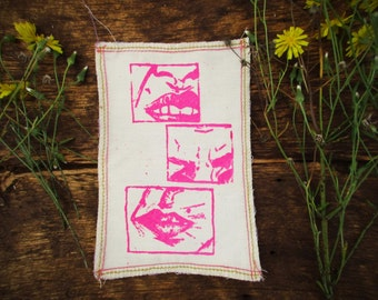 Pink Snarling Faces Comic Strip patch with Serged Edges