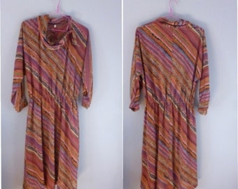 80s retro dress. XL size. Jersey multicolor dress with lined skirt & round neckline with endorsed scarf. In a very good vintage condition.