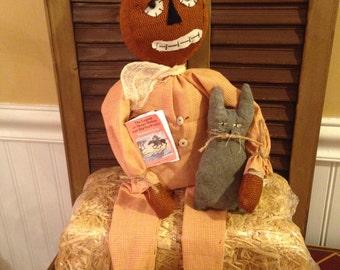 Primitive Halloween Pumpkin Man Doll in Pajamas holding cat and book, Handmade Halloween Pumpkin Doll