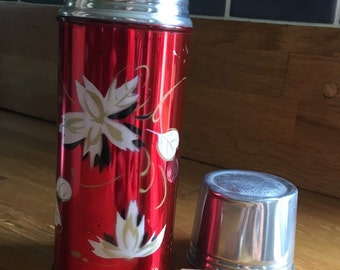 Beautiful Red 1940s vintage flask with lotus flower design and cork stopper