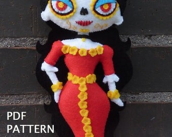PDF pattern to make a felt Catrina.