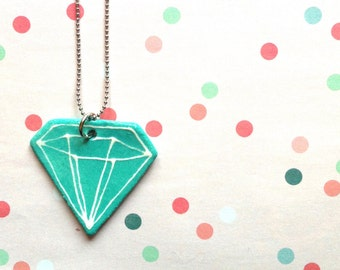 Necklace made of chain pellets with a diamond shaped turquoise ceramic pendant