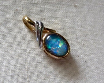 Opal Pendant in gold with silver accent