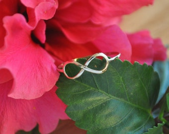 14kt yellow gold infinity ring also available in 14kt rose gold