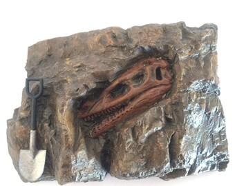 Velociraptor faux fossil skull with shovel