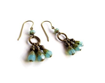 Calypso earrings with faceted blue Czech glass