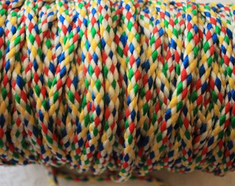 Three yards of Multicoloured nylon cord, white, red, yellow and blue