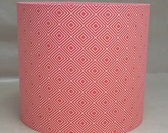 Handmade lampshade made with repeated geometric square pattern in orange and white