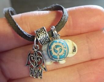 hamsa, elephant, blue rose, suede charm necklace