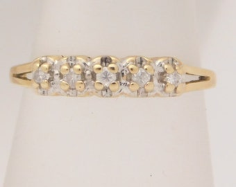 0.10 Carat T.W. Ladies Round Cut Diamond Band 10K