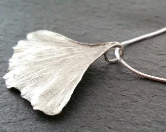 shoulder-length necklace with a leaf of ginkgo biloba