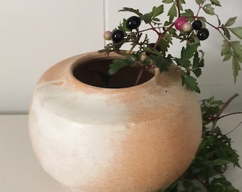 White and earthy orange closed-mouth vase