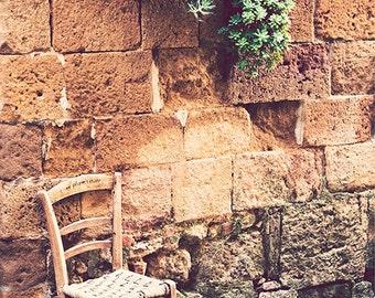 Tuscany photography, Tuscany street, vintage photography, Italy photography, chair, old stone wall. Fine Art photography Siena, Italy
