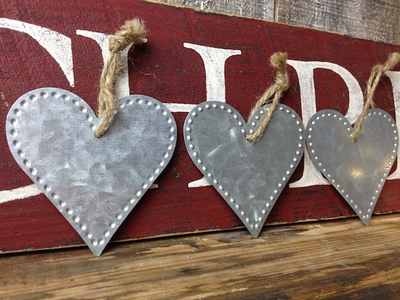 Set of galvanized metal heart ornaments knobby rustic