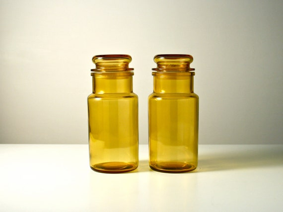 glass storage jars two dark yellow apothecary type kitchen containers