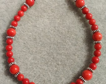 Red coral with sterling silver.