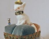Sweater Felt Kitty Pincushion on a vintage velvet and chintz tuffet