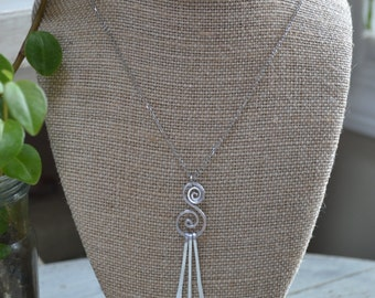 Aluminum Swirl with dangles on Silver Chain