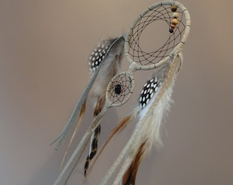 Dreamcatcher. Feathers, recycled leather, wood beads, obsidian. Native American Spirituality. Grizzly Rooster Guinea fowl. Dream Catcher