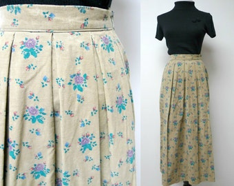 "Russ . floral print . brown corduroy pleated skirt . size 8 / 23"" - 27"" waist . made in USA / union made"
