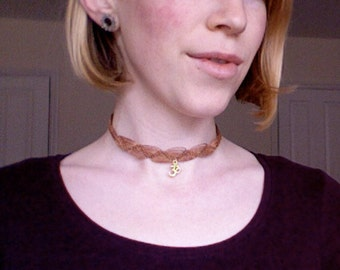 Light brown macrame choker with Om symbol charm