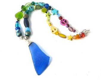 Silver Wire Wrapped Cobalt Blue Sea Glass on a Rainbow of Beads Necklace with a Sterling Silver Toggle Clasp