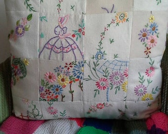Patchwork cushion made from vintage embroidery and linen.