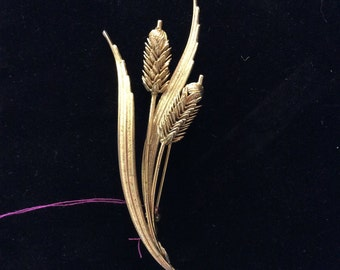 Gold colored wheat brooch pin