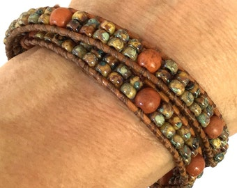 Earth-toned glass and howlite beaded leather wrap bracelet