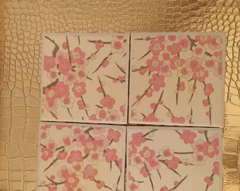set of four handmade light pink floral coasters