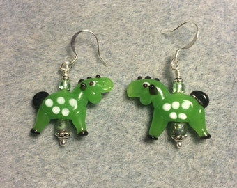 Opaque bright green with white spots lampwork horse  earrings adorned with green Czech glass beads.