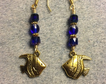 Gold angelfish charm dangle earrings adorned with cobalt blue Czech glass beads.