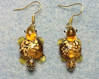 Spotted amber lampwork turtle bead earrings adorned with amber Czech glass beads.