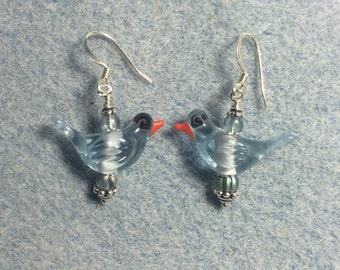 Transparent blue lampwork songbird dangle earrings adorned with light blue Czech glass beads.