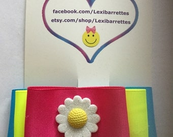 Blue, yellow and pink flower barrette