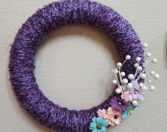Purple Yarn Wreath, 12-inch with multi-colored flowers and white spray
