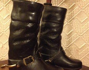 Antique ceramic liquor decanter as a black riding boots