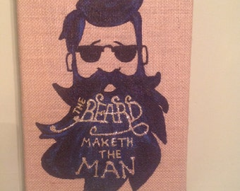 Blue/black bearded man on a burlap stretched canvas.
