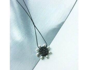 Pearl sun pendant