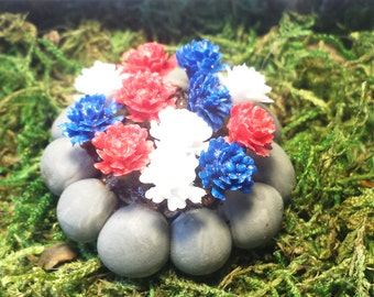 Miniature round rock flower bed. Red, white, and blue flowers. Fairy garden accessories, dollhouse, terrarium décor.
