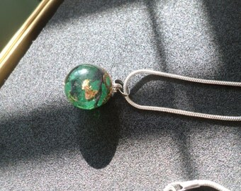 Homemade necklace with green resin pendant